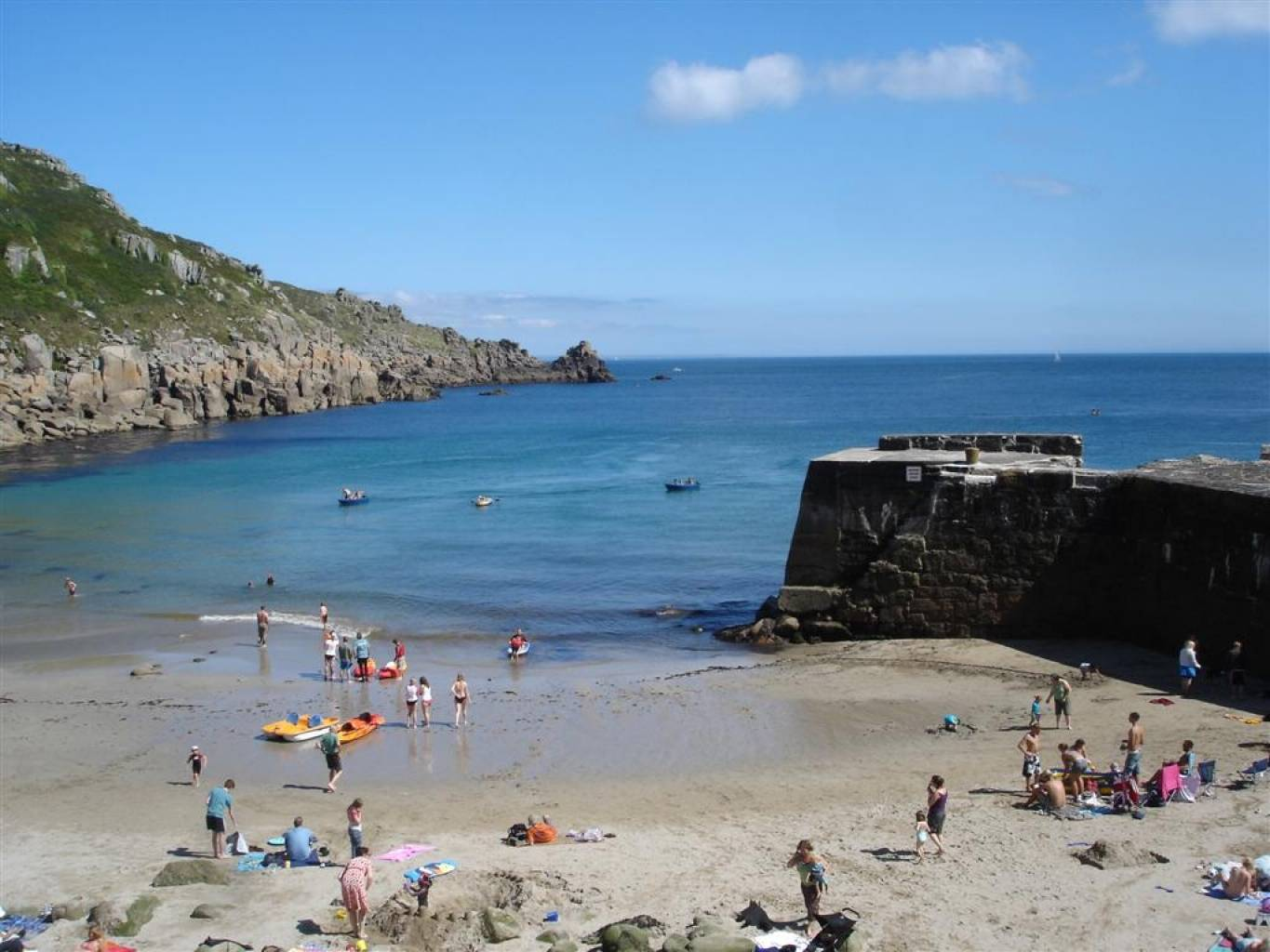 Holidaymakers enjoying the beach at Lamorna Cove